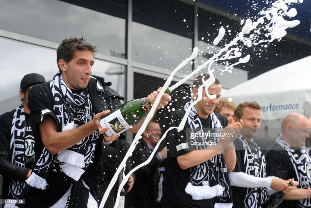 Leandro Grech of Aalen celebrates victory and promotion after the Third League match between VfR Aalen and VfL Osnabrueck at ScholzArena on May 5...
