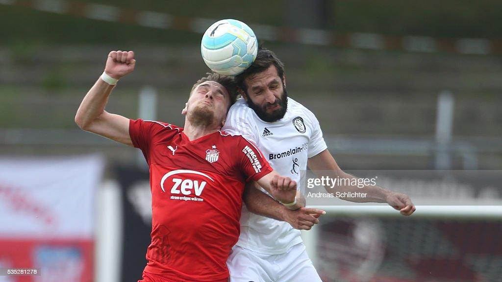 Leandro Grech of Elversberg challenges Jonas Nietfeld of Zwickau during Regionalliga Playoffs match between FSV Zwickau and SV Elversberg on May 25 on May 29, 2016 in Plauen, Germany.