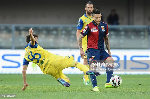 Leandro Greco of Genoa CFC competes the ball with Perparim Hetemaj of AC Chievo Verona during the Serie A match between AC Chievo Verona and Genoa...