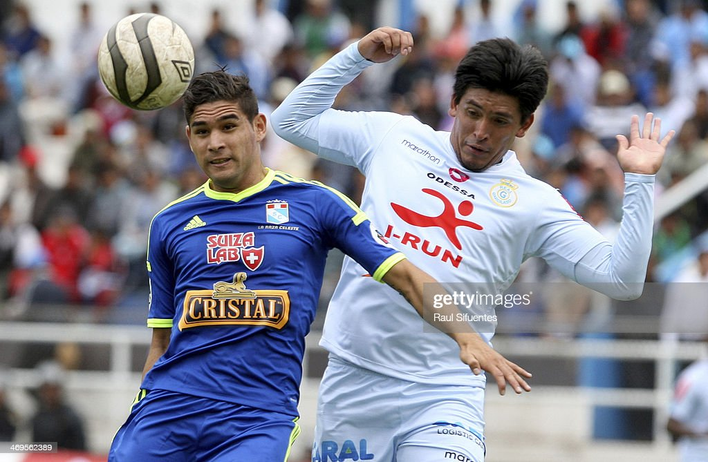 Leandro Leguizamon (L) of Sporting Cristal struggles for the ball with Jaime Huerta (R) of Real Garcilaso during a match between Real Garcilaso and Sporting Cristal as part of the Copa Inca at Municipal de Urcos Stadium on Februay 15, 2014 in Cuzco, Peru.