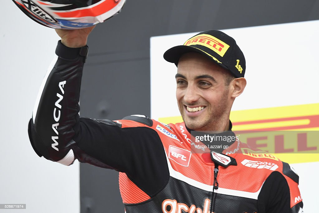 Leandro Marcado of Spain and Aruba.it - Junior Team celebrates the victory on the podium at the end of the Superstock 1000 race during the World Superbikes - Race at Enzo & Dino Ferrari Circuit on May 10, 2015 in Imola, Italy.