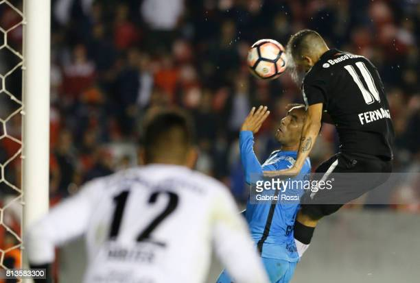 Leandro Miguel Fernandez of Independiente heads the ball to score the third goal of his team during the first leg match between Independiente and...