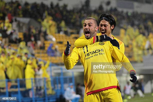 Leandro Montera Da Silva of Kashiwa Reysol celebrates his team's third goal with his team mate Daisuke Suzuki during the AFC Champions League playoff...