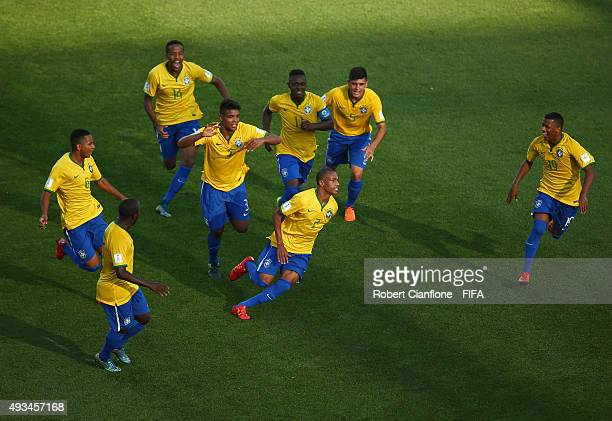Leandro of Brazil celebrates with team mates after scoring a goal during the FIFA U17 World Cup Group B match between England and Brazil at Estadio...