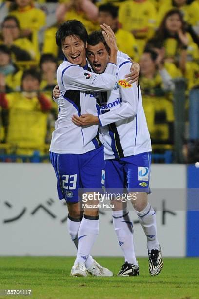 Leandro of Gamba Osaka celebrates the first goal with Takuya Takei during the JLeague match between Kashiwa Reysol and Gamba Osaka at Hitachi Kashiwa...