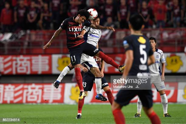 Leandro of Kashima Antlers and Yasuyuki Konno of Gamba Osaka compete for the ball during the JLeague J1 match between Kashima Antlers and Gamba Osaka...