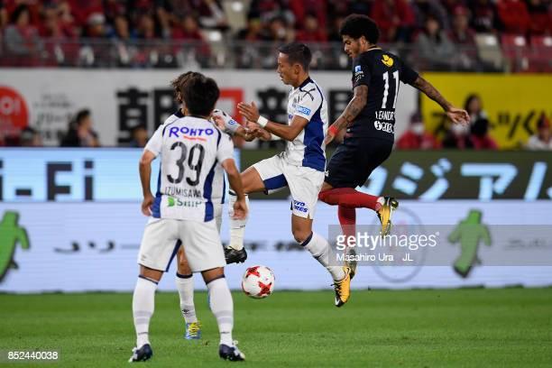 Leandro of Kashima Antlers and Yosuke Ideguchi o Gamba Osaka compete for the ball during the JLeague J1 match between Kashima Antlers and Gamba Osaka...