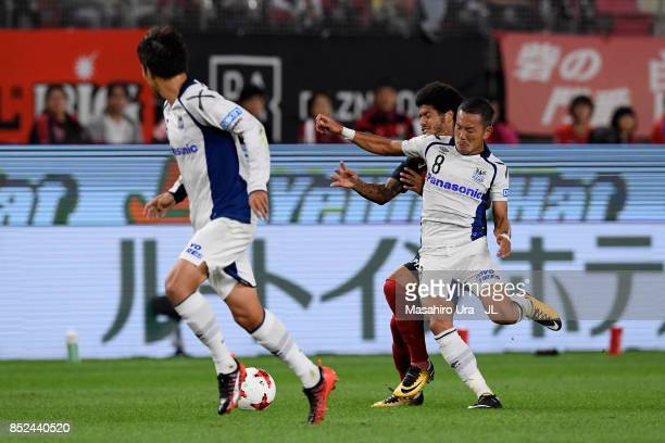Leandro of Kashima Antlers and Yosuke Ideguchi of Gamba Osaka compete for the ball during the JLeague J1 match between Kashima Antlers and Gamba...