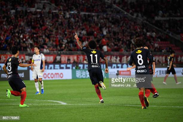 Leandro of Kashima Antlers celebrates scoring his side's first goal during the JLeague J1 match between Kashima Antlers and Gamba Osaka at Kashima...