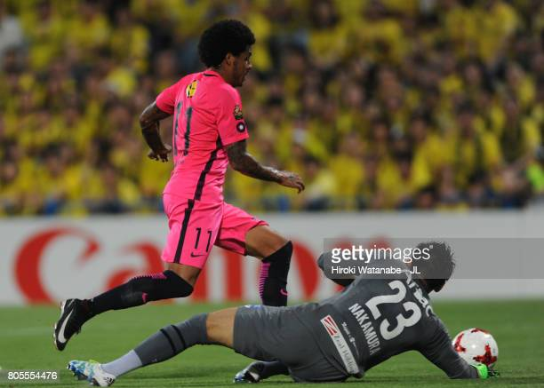 Leandro of Kashima Antlers goes past Kosuke Nakamura of Kashiwa Reysol during the JLeague J1 match between Kashiwa Reysol and Kashima Antlers at...