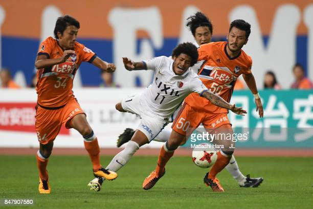Leandro of Kashima Antlers is challenged by Teruki Hara of Albirex Niigata during the JLeague J1 match between Albirex Niigata and Kashima Antlers at...