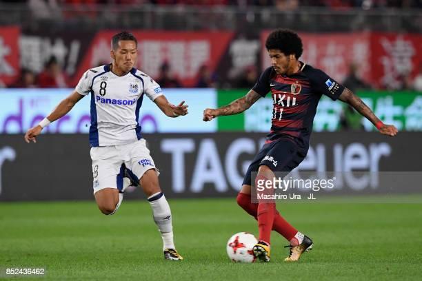 Leandro of Kashima Antlers takes on Yosuke Ideguchi of Gamba Osaka during the JLeague J1 match between Kashima Antlers and Gamba Osaka at Kashima...