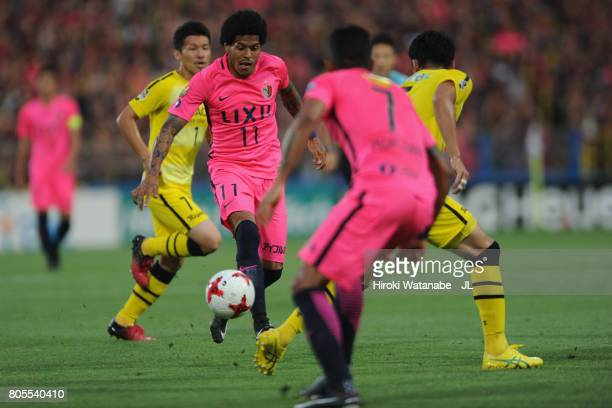 Leandro of Kashima Antlers takes on Yuta Nakayama of Kashiwa Reysol during the JLeague J1 match between Kashiwa Reysol and Kashima Antlers at Hitachi...