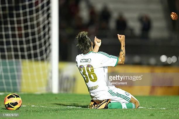 Leandro of Palmeiras celebrates a scored goal against Atletico Paranaense during a match between Atlético Paranaense and Palmeiras as part of the...