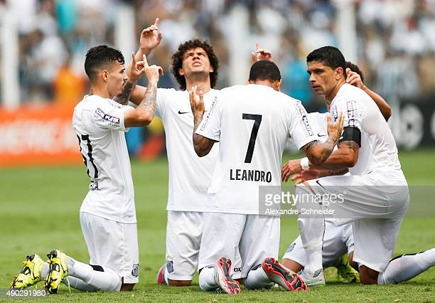 Leandro of Santos celebrates their thirth goal with his teammates during the match between Santos and Internacional for the Brazilian Series A 2015...