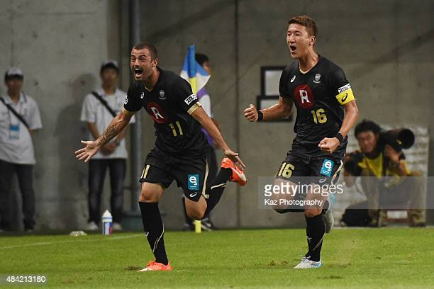 Leandro of Vissel Kobe celebrates the opener with Jung Woo Young of Vissel Kobe during the JLeague match between Vissel Kobe and Kawasaki Frontale at...