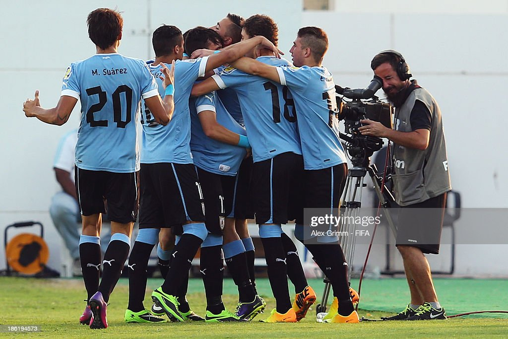 Leandro Otormin of Uruguay celebrates his team's first goal with team mates during the FIFA U-17 World Cup UAE 2013 Round of 16 match between Uruguay and Slovakia at Ras Al Khaimah Stadium on October 29, 2013 in Ras al Khaimah, United Arab Emirates.