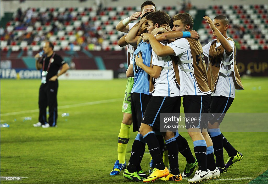 Leandro Otormin of Uruguay celebrates his team's fourth goal with team mates during the FIFA U-17 World Cup UAE 2013 Round of 16 match between Uruguay and Slovakia at Ras Al Khaimah Stadium on October 29, 2013 in Ras al Khaimah, United Arab Emirates.