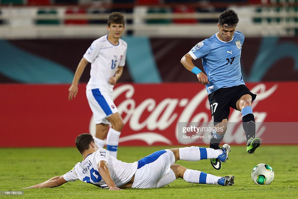 Leandro Otormin (R) of Uruguay is challenged by Juraj Chvatal of Slovakia during the FIFA U-17 World Cup UAE 2013 Round of 16 match between Uruguay and Slovakia at Ras Al Khaimah Stadium on October 29, 2013 in Ras al Khaimah, United Arab Emirates.