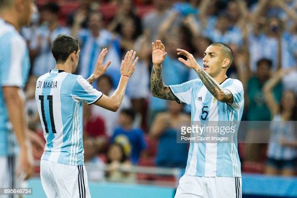 Leandro Paredes of Argentina celebrates his score with Angel Di Maria during the International Test match between Argentina and Singapore at National...