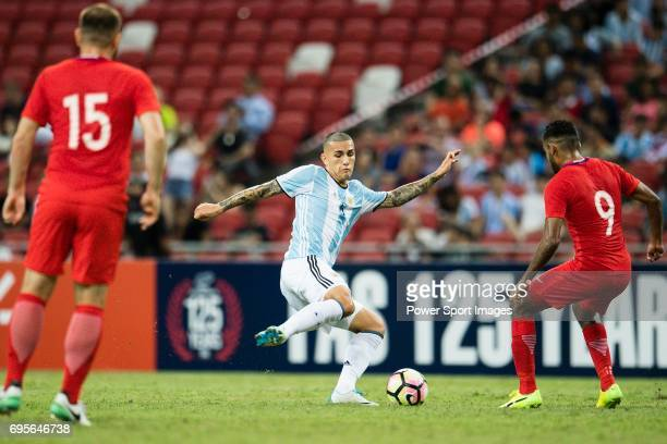 Leandro Paredes of Argentina fights for the ball with Faritz Hameed of Singapore during the International Test match between Argentina and Singapore...