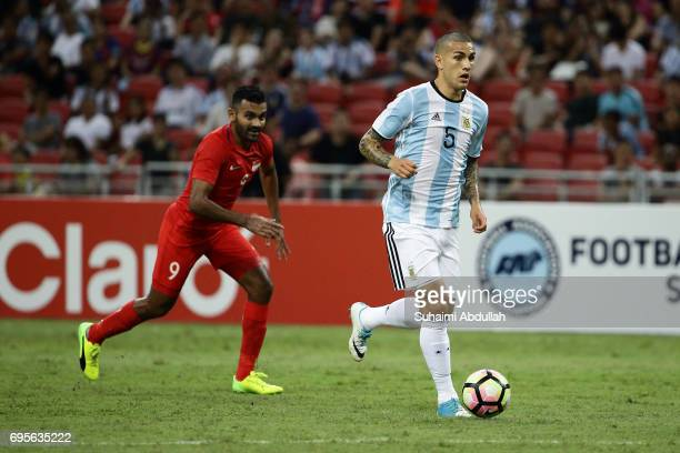 Leandro Paredes of Argentina runs with the ball during the International Test match between Argentina and Singapore at National Stadium on June 13...