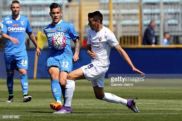 Leandro Paredes of Empoli FC battles for the ball with Matias Vecino of ACF Fiorentina during the Serie A match between Empoli FC and ACF Fiorentina...