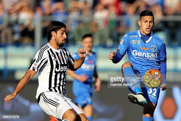 Leandro Paredes of Empoli FC battles for the ball with Sami Khedira of Juventus FC during the Serie A match between Empoli FC and Juventus FC at...