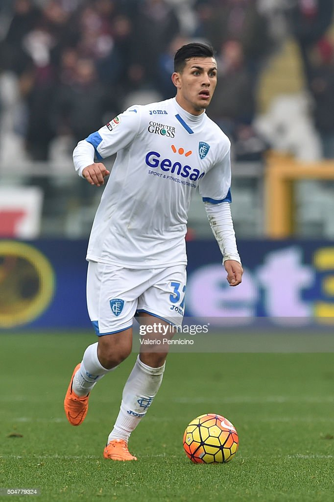 <a gi-track='captionPersonalityLinkClicked' href=/galleries/search?phrase=Leandro+Paredes&family=editorial&specificpeople=7626324 ng-click='$event.stopPropagation()'>Leandro Paredes</a> of Empoli FC in action during the Serie A match between Torino FC and Empoli FC at Stadio Olimpico di Torino on January 10, 2016 in Turin, Italy.