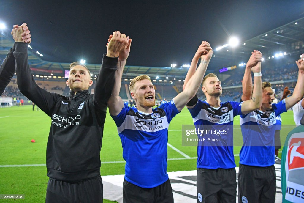 Leandro Putaro, Andreas Voglsammer, Florian Hartherz and Konstantin Kerschbaumer of Bielefeld celebrate after winning the Second Bundesliga match between DSC Arminia Bielefeld and VfL Bochum 1848 at Schueco Arena on August 21, 2017 in Bielefeld, Germany.