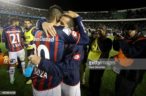 Leandro Romagnoli and Nestor Ortigoza of San Lorenzo celebrate after a second leg semifinal match between Bolivar and San Lorenzo as part of Copa...