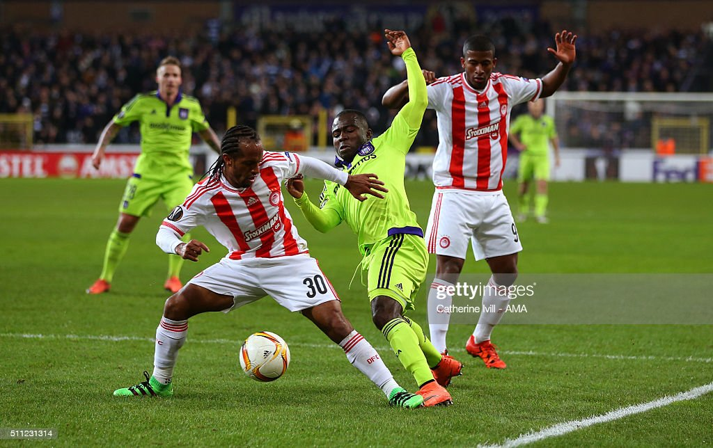 Leandro Salino of Olympiacos tackles Frank Acheampong of Anderlecht in the penalty area during the UEFA Europa League match between Anderlecht and...