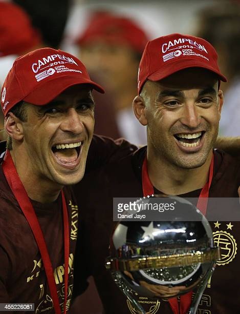 Leandro Somoza and Santiago Silva of Lanus celebrate at the end of the final match between Lanus and Ponte Preta as part of the Copa TOTAL...