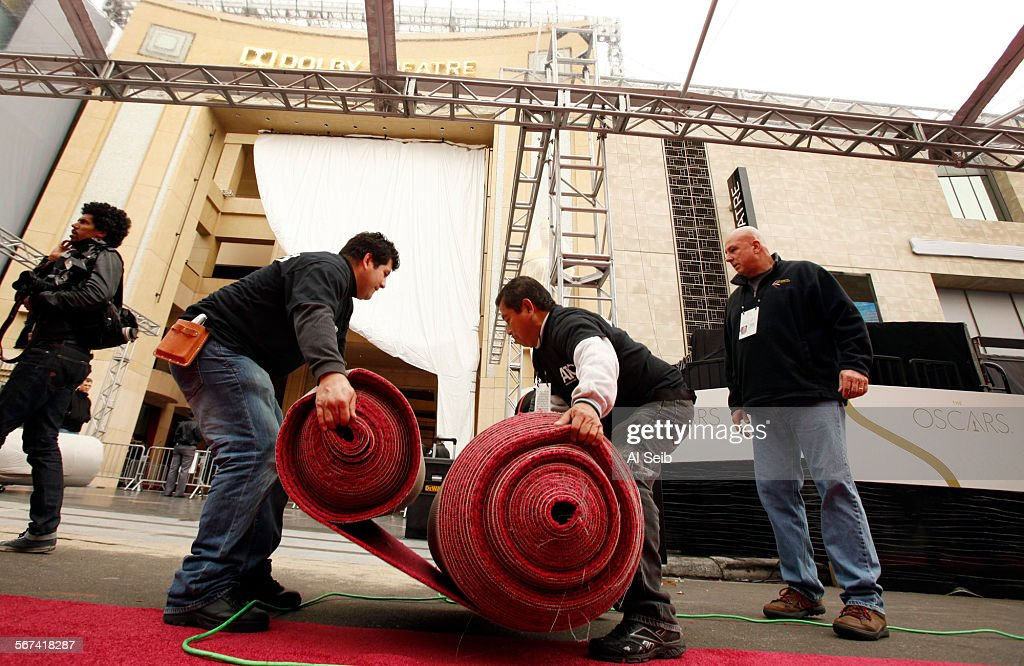 Leandro Torres left and Mario Hernandez right from American Turf and Carpet position red carpet just rolled out on Hollywood Blvd in front of the...