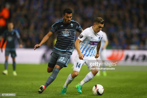 Leandro Trossard of Genk holds off Gustavo Cabral of Celta Vigo during the UEFA Europa League quarter final second leg between KRC Genk and Celta...