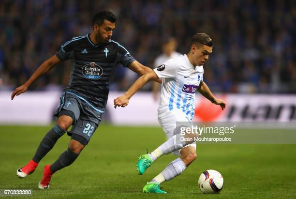 Leandro Trossard of Genk holds off Idrissa Doumbia of RSC Anderlecht during the UEFA Europa League quarter final second leg between KRC Genk and...