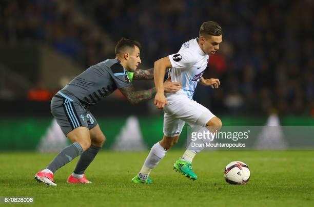 Leandro Trossard of Genk holds off Mallo of Celta Vigo during the UEFA Europa League quarter final second leg between KRC Genk and Celta Vigo at...