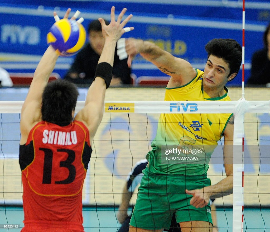 http://media.gettyimages.com/photos/leandro-vissotto-neves-of-brazil-spikes-the-ball-past-kunihiro-of-picture-id93323412