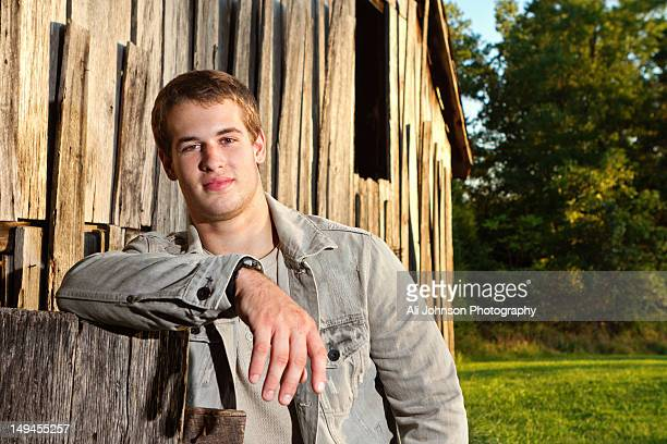 Leaning against a barn