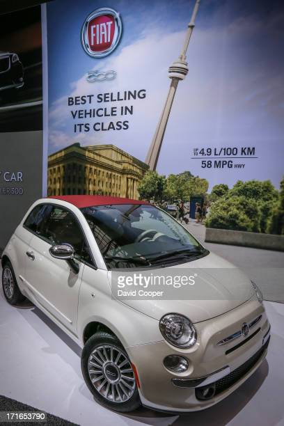A leaning CN Tower sits behind the Fiat 500 during the CIAS 2013 Canadian International AutoShowat the Metro Toronto Convention Centre February 22...