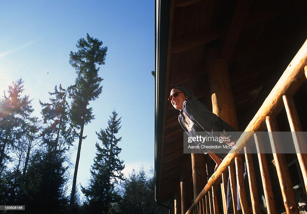 leaning over the rail : Stock Photo