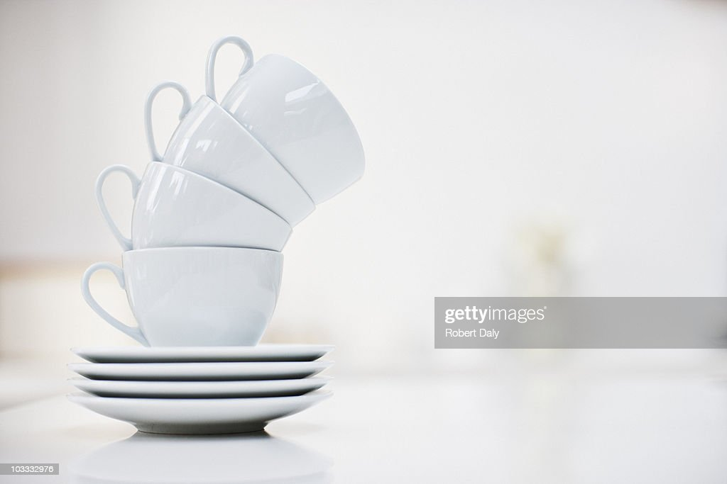 Leaning stack of coffee cups : Stock Photo