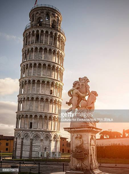 Leaning Tower of Pisa and statue, Pisa, Tuscany, Italy
