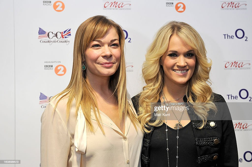 LeAnn Rimes (L) and Carrie Underwood pose backstage prior to performing as part of the Country 2 Country tour at O2 Arena on March 17, 2013 in London, England.