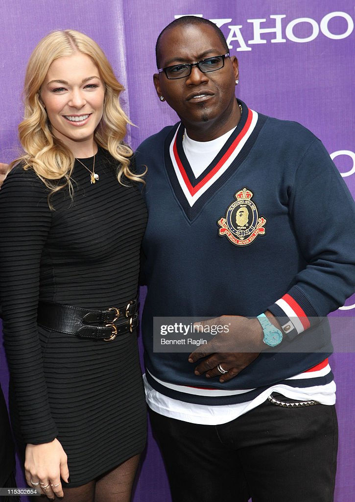 LeAnn Rimes and Randy Jackson attend the It's Y!ou Yahoo! yodel competition at Military Island, Times Square on October 13, 2009 in New York City.