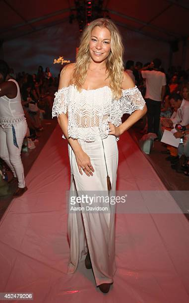 LeAnn Rimes attends Luli Fama fashion show during MercedesBenz Fashion Week Swim 2015 at Cabana Grande at The Raleigh on July 20 2014 in Miami Florida