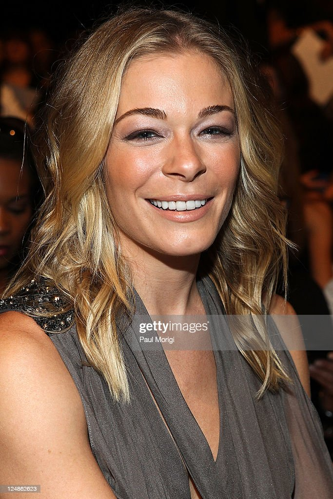LeAnn Rimes attends the Badgley Mischka Spring 2012 fashion show during MercedesBenz Fashion Week at The Theater at Lincoln Center on September 13...
