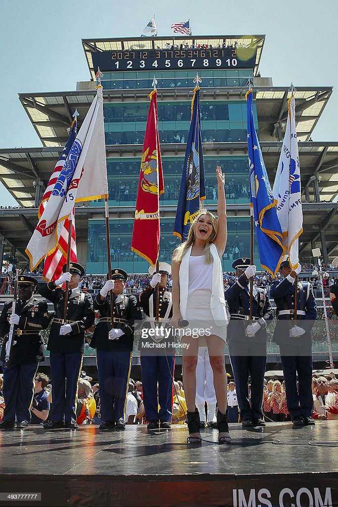 LeAnn Rimes reacts after singing the National Anthem at the 2014 Indy 500 at Indianapolis Motorspeedway on May 25, 2014 in Indianapolis, Indiana.