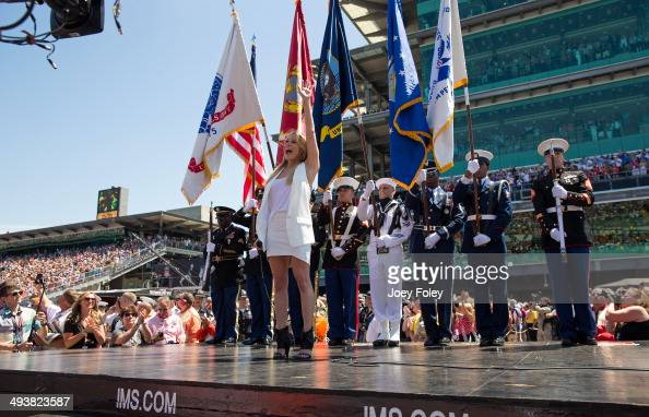 LeAnn Rimes sings the National Anthem during the 2014 Indy 500 at Indianapolis Motor Speedway on May 25 2014 in Indianapolis Indiana