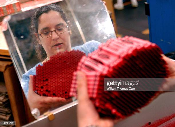 Leanne Ferroni is reflected in a mirror as she inspects crayons at Binney and Smith Inc the manufacturer of Crayola crayons June 18 2003 in Easton...